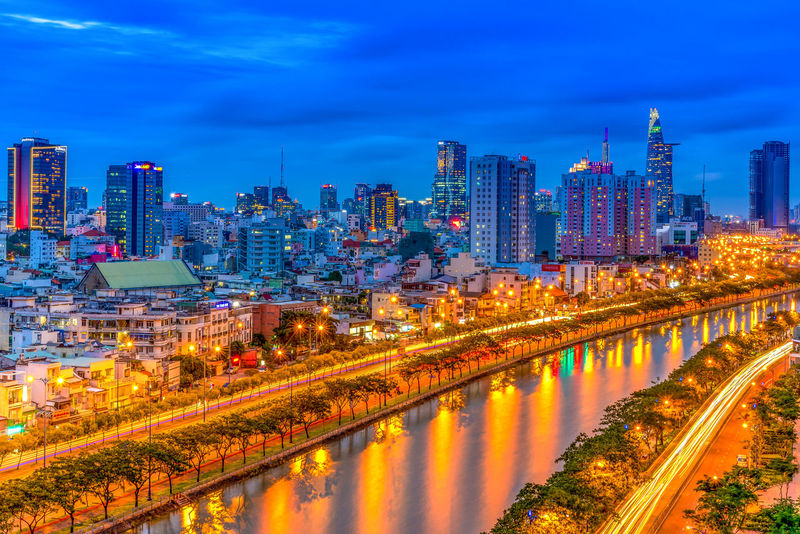 Blue hour in Saigon city, Vietnam. City Architecture Building Exterior Office Building Exterior Building Built Structure Skyscraper Urban Skyline Landscape Illuminated Sky Reflection Cityscape Water Tower Nature City Life Modern Dusk No People Outdoors Financial District