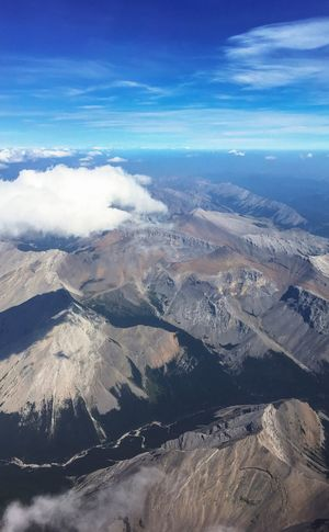 Canadian Rockies from the air in summer Alberta Canada Canadian Rockies  Cloud - Sky Scenics - Nature Beauty In Nature Sky Tranquil Scene Environment Tranquility Landscape Mountain Nature No People Aerial View Day Mountain Range Remote High Angle View Outdoors