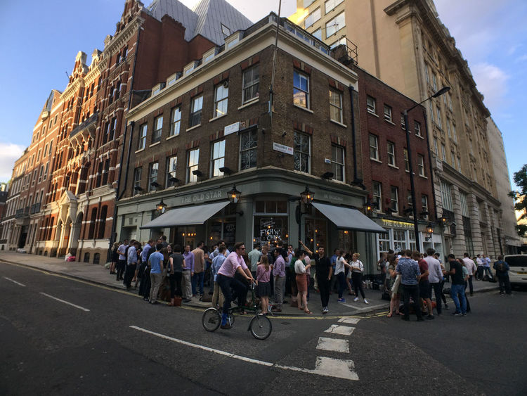 People gather outside a local pub on a warm summer evening after work. London Pub Adult Architecture Bicycle Building Exterior Built Structure City Citylife Day Editorial  Large Group Of People Men Outdoors People Real People Road Sky Street Streetphotography Transportation Women