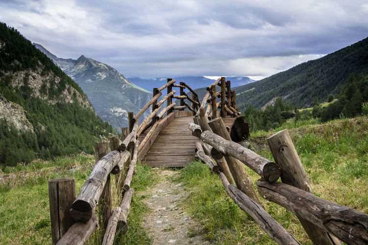 wooden bridge Alps Bridge Environment Green Color Hiking Landscape_photography Mountain Mountain View Nature Nature No People Nobody Outdoors Scenics Sky Steep Steps Sunset Tops Tourism Traveling Trekking Wood