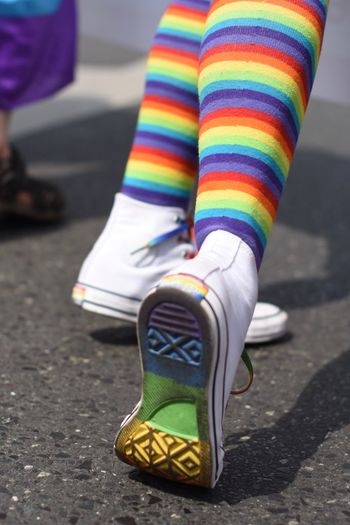 Low Section Of Person Wearing Rainbow Colored Socks