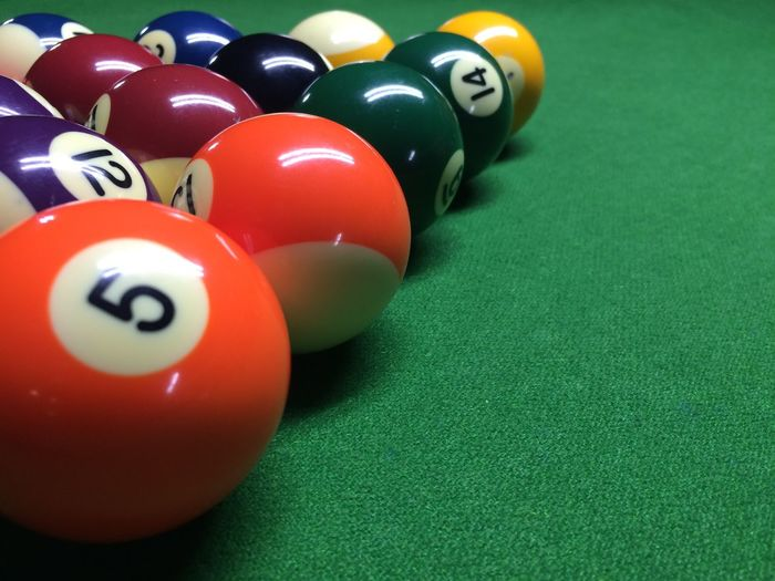 Close-up of colorful balls on pool table