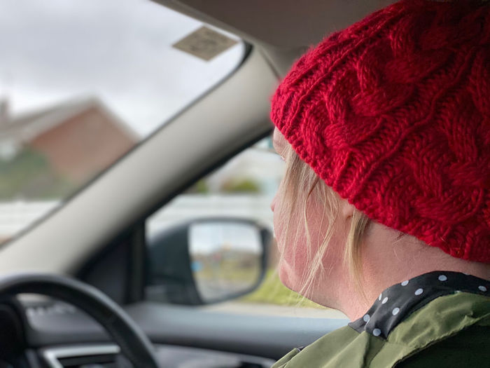 Close-up portrait of a woman in car