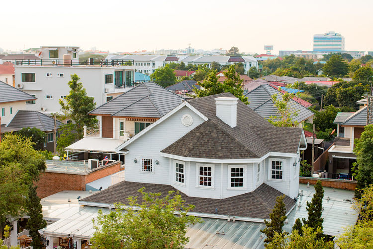 High angle view of houses against sky