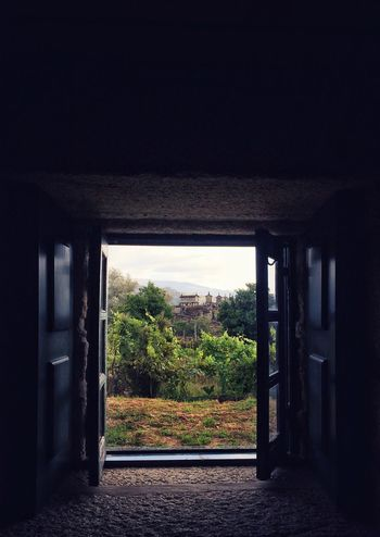 """A view from the window to """"espigueiros"""" - rock structures used to dry crop and maize in North of Portugal / Built Structure Window View From The Window... Indoors  The Week On EyeEm Dark Espigueiros Soajo North Of Portugal Maize Crops Drying Rock - Object"""