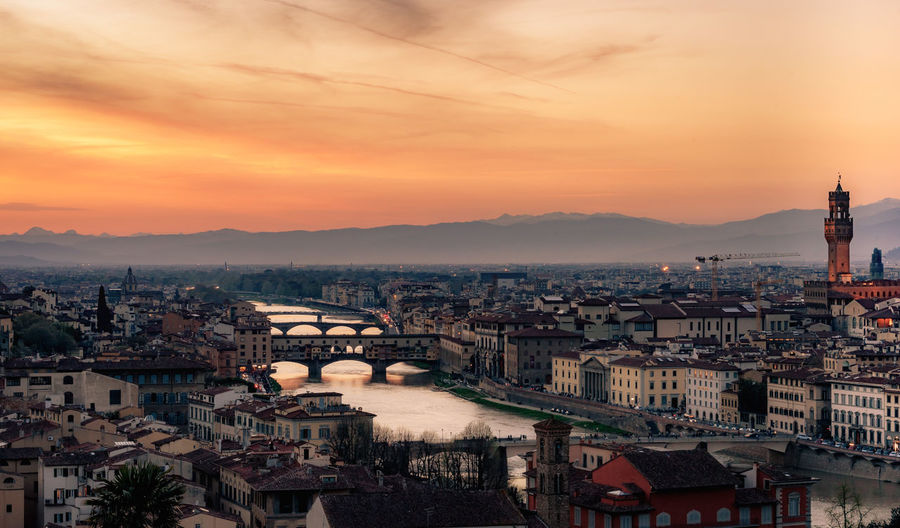 Florence Italy Architecture Bridge Bridge - Man Made Structure Building Building Exterior Built Structure City Cityscape Cloud - Sky Connection High Angle View Nature Outdoors Ponte Vecchio Residential District River Sky Sunset TOWNSCAPE Water