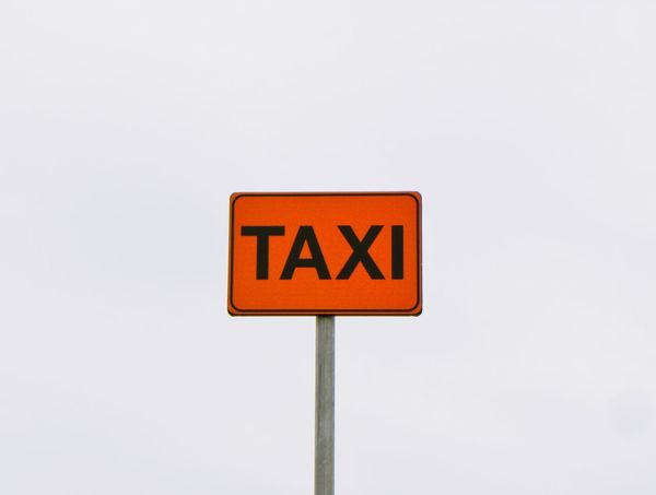 Communication Road Sign Single Object Text No People Guidance Outdoors Day Instructions Sky Red Close-up Copy Space Emphatic Colours Taxi Stop Taxi Sign Taxi Made By Man Empty Low Angle View Street Signs