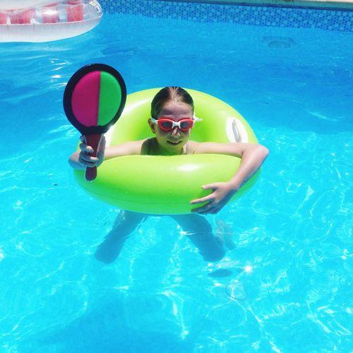 Having fun in the pool, colourful girl