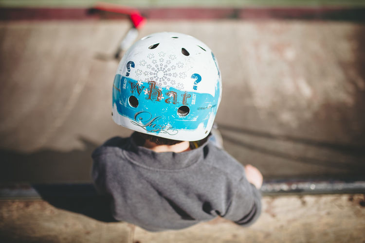 Rear View Of Boy Wearing Helmet At Skateboard Park