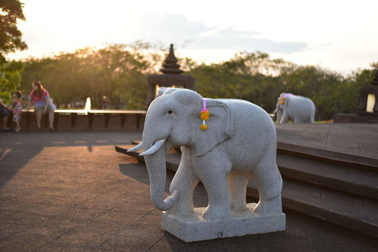 Elephant statue on field at temple
