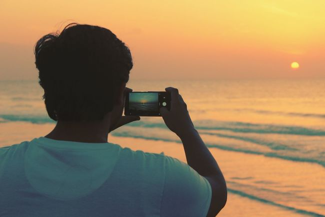 Photography Themes Photographing Sunset Only Women Adult Adults Only One Woman Only Holding One Person People Headshot Silhouette Camera - Photographic Equipment Sea Photographer Outdoors Sky Beach Women One Young Woman Only The Week On EyeEm Connected By Travel