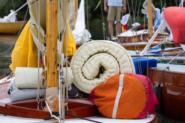 Close-up of luggage near mast on boat