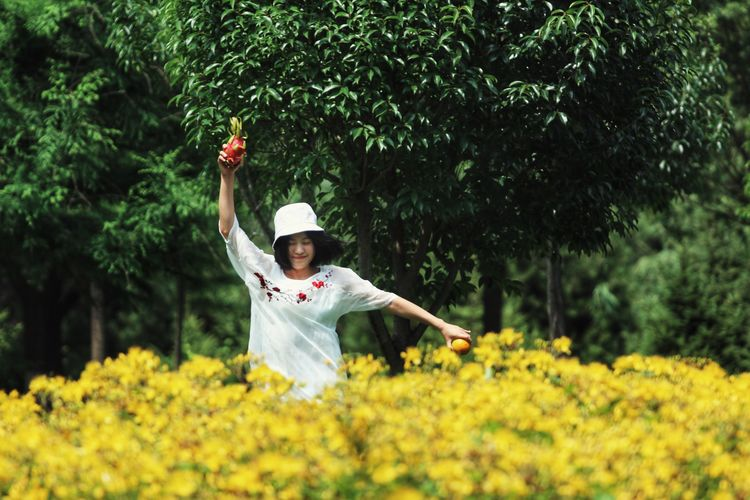 Plant Flower Flowering Plant One Person Nature Human Arm Tree Childhood Child Hat Emotion Adult Clothing Arms Raised Beauty In Nature Men Growth Yellow Front View Outdoors