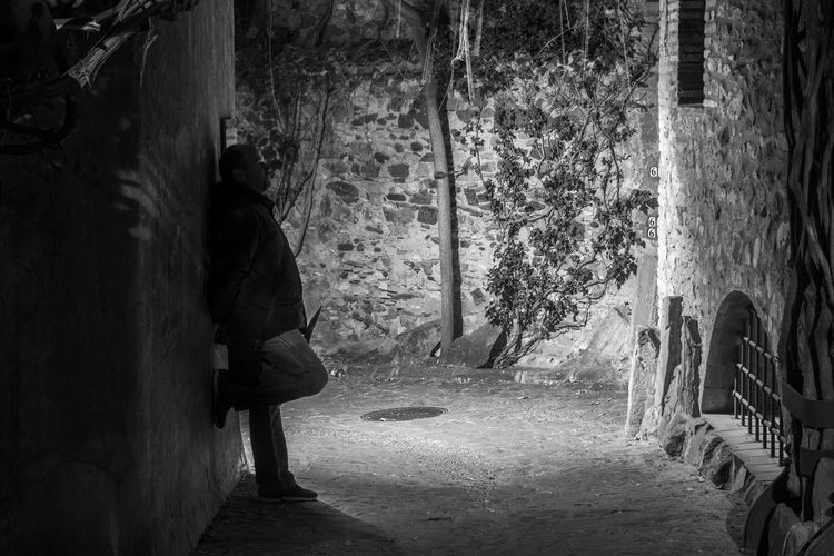 I'll wait here The Art Of Street Photography Real People Full Length Tree One Person Rear View Trunk Tree Trunk Lifestyles Architecture Plant Men Adult Outdoors Standing Night Shades Silhouette Blackandwhite Waiting The Street Photographer - 2019 EyeEm Awards