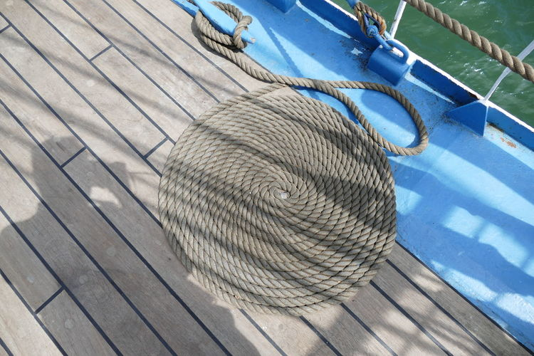 High Angle View Of Rope Arranged On Boat