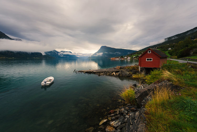 Place to be Water Cloud - Sky Sky Beauty In Nature Scenics - Nature Mountain Nature Transportation Lake Nautical Vessel Tranquil Scene No People Built Structure Day Architecture Tranquility Mode Of Transportation Non-urban Scene Outdoors Norway Fjord Fjordsofnorway Boat Paradise Earth