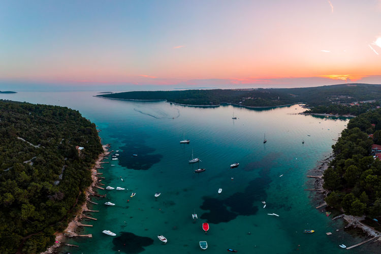 Water Sky Scenics - Nature Sea Sunset Beauty In Nature Nature Nautical Vessel Transportation High Angle View Mode Of Transportation Plant Tranquil Scene No People Tranquility Land Travel Tree Beach Outdoors Bay Drone  Dronephotography Dji DJI Mavic Air Aerial View Aerial Shot Aerial Photography