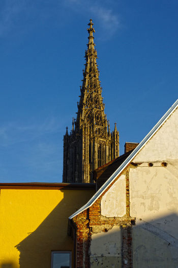 Low angle view of ulm cathedral against clear blue sky