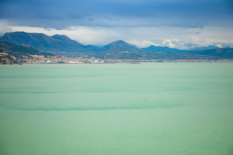 Italy Scenics - Nature Mountain Sky Water Beauty In Nature Tranquil Scene Tranquility Sea Waterfront Cloud - Sky Nature Day Land No People Mountain Range Idyllic Environment Outdoors Non-urban Scene Turquoise Colored View Into Land