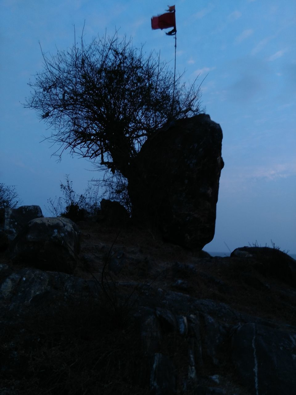 sky, nature, rock - object, flag, outdoors, landscape, no people, beauty in nature, day, tree
