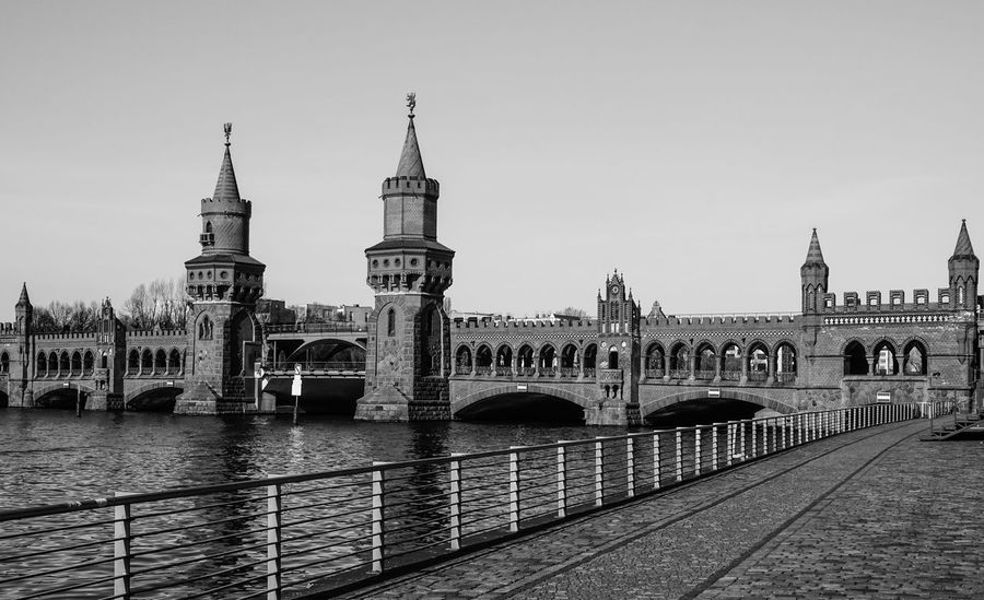Arch Arch Bridge Architecture B&w Bridge Bridge - Man Made Structure Building Exterior Built Structure City Clear Sky Clock Tower Connection Culture Engineering Famous Place Geländer International Landmark Oberbaumbrücke Railing River Spree Tourism Tower Travel Destinations Water
