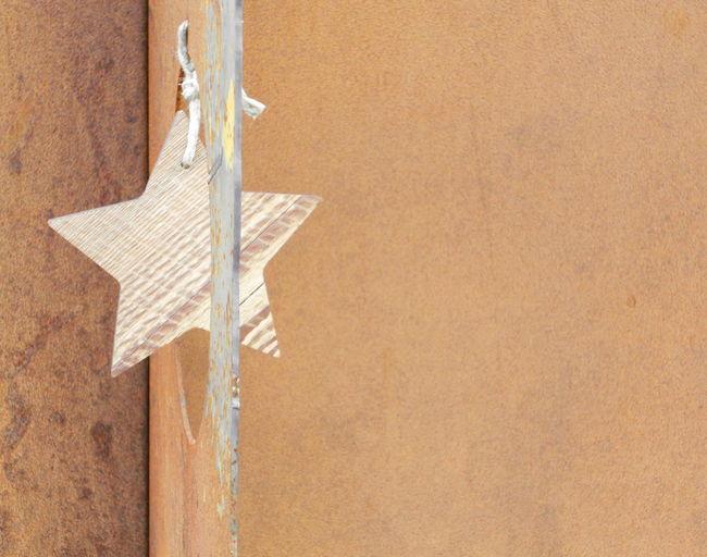 Star shape hanging on wood