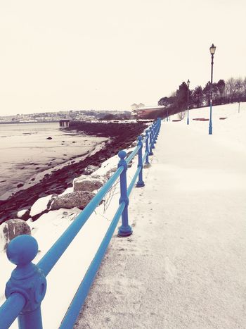 Blue in the snow Beast From The East Snow ❄ Winter Wonderland Winterwalks Walking Winter Nature Waterfront Pembrokeshire Coast Wales UK Wales❤ Pembrokeshire Calmness Still Blue Bluecolour Bluecollection Bluecolor Railings