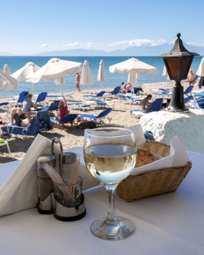 Close-up of wine on table at beach