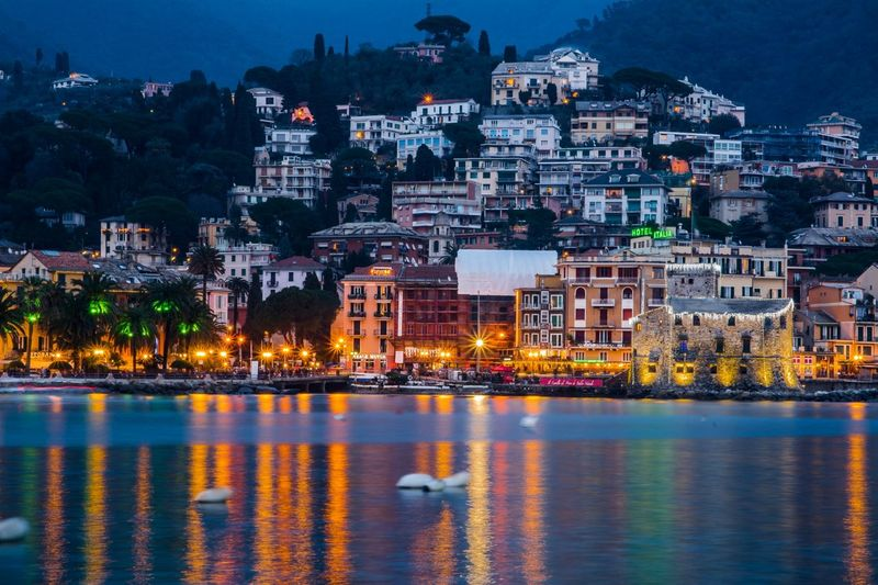 Rapallo, Genova Liguria Night Cityscape Travel Destinations Building Exterior Urban Skyline Outdoors Architecture City Water Sunset Downtown District Illuminated Business Finance And Industry No People Harbor Modern Sky rapallo liguria
