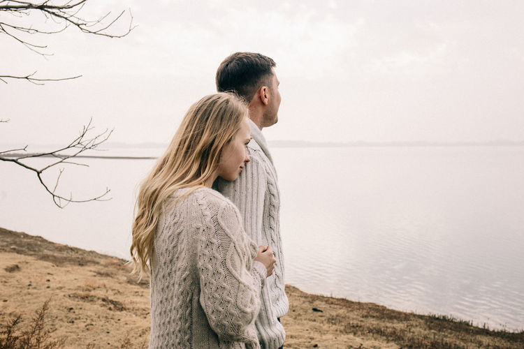 Couple standing by lake