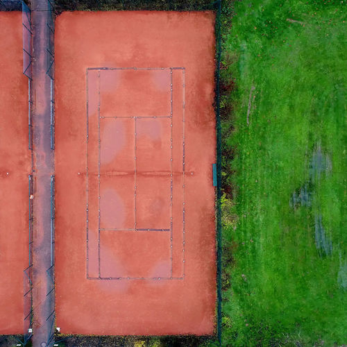 Tennis court with red gravel next to a lawn, abstract effect by vertical aerial photograph with drone Aerial Shot Drone  Drone Dji Drone Shot Grass Lines Straight Abstract Aerial Aerial Photography Aerial View Architecture Day Lawn Lines And Patterns Lines And Shapes Net No People Outdoors Tennis Court Tennis 🎾 The Graphic City