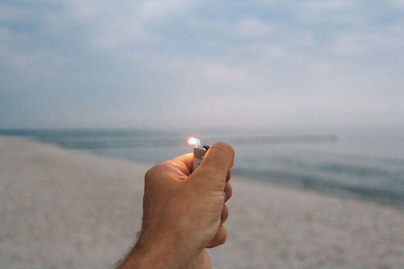 Hand Holding Cigarette Lighter
