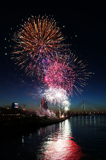 Architecture Arts Culture And Entertainment Building Exterior Built Structure Celebration City Cityscape Event Exploding Firework Firework - Man Made Object Firework Display Illuminated Multi Colored Night No People Outdoors Sky Water Waterfront River