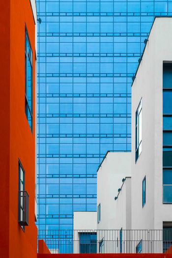 The colorful forest of buildings Architecture Built Structure Building Exterior Building Blue Day Window Wall - Building Feature No People City Glass - Material Residential District Outdoors Sunlight Low Angle View Modern Nature Wall Orange Color White Color