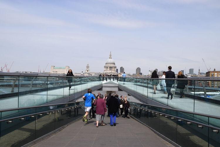 People On London Millennium Footbridge Leading Towards St Pauls Cathedral