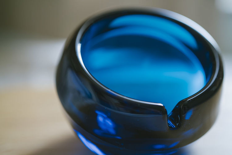 High angle view of blue glass on table