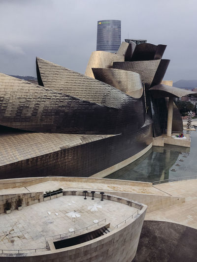 Guggenheim Bilbao Museum Architecture Basque Country Bilbao Cityscape Guggenheim Museum Of Modern Art SPAIN Sightseeing Tourist Attraction  Traveling Architecture Art Building Building Exterior Built Structure Design Famous Place Guggenheim Bilbao Landmark Modern Museum Tourism Tourist Destination Travel Travel Destinations