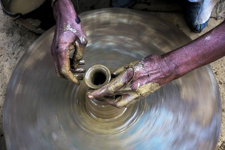 Cropped Hands Of Potter Making Pot