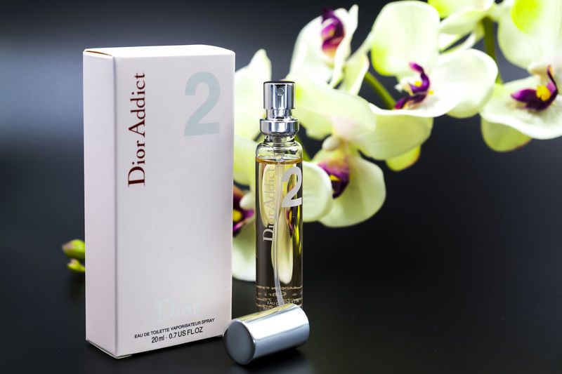 A display on wallet size Dior Addict 2 perfume Dior Addict 2 Editorial  Elégance Illustration No People Perfume Perfume Collection Simple Small Size Wallet Size