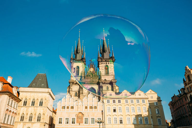 Low Angle View Of Historic Church Seen Through Bubble Against Blue Sky