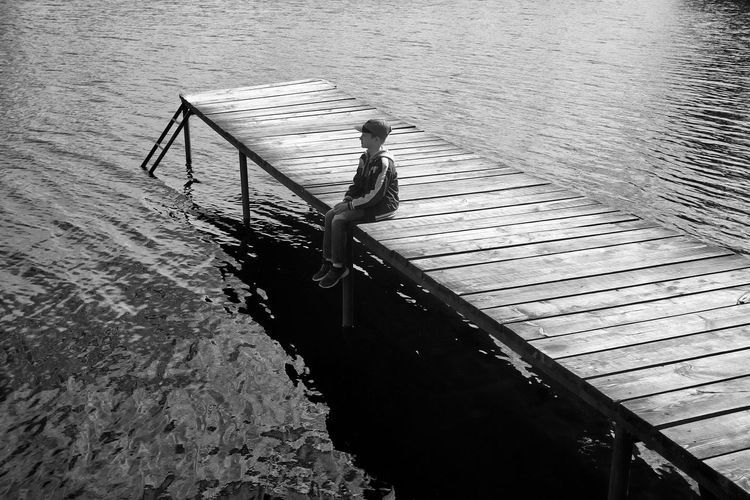 High angle view of woman on pier over lake