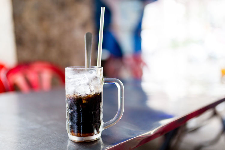 Ca Phé (1) - Food in Vietnam (Ho Chi Minh City, VN, 2019) #BlackAndWhite #Coffee #Milk #Sugar #VietnameseCoffee Drink Refreshment Food And Drink Household Equipment Table Drinking Glass Focus On Foreground Glass Close-up Cup Straw Drinking Straw Freshness Still Life Coffee - Drink Day Indoors  Mug Coffee Cold Temperature