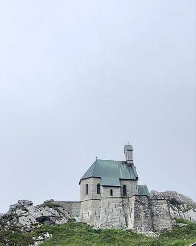 Church on a mountain peak Built Structure Architecture Building Exterior Sky Building Copy Space Day No People Place Of Worship Low Angle View Belief Religion Outdoors History The Past