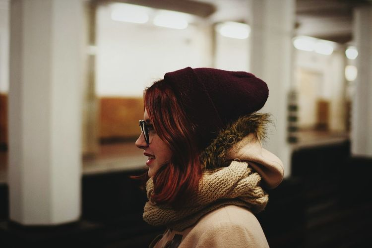 Close-up of young woman in warm clothing