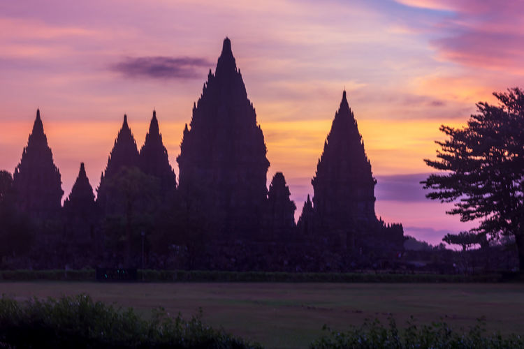 Hinduism UNESCO World Heritage Site Architecture Beauty In Nature Built Structure Day Hindu Culture Hindu Temple Nature No People Outdoors Prambanan Prambanan Temple Scenics Silhouette Sky Sunset Tranquility Tree