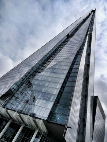 The Shard Sky Low Angle View Architecture Cloud - Sky Built Structure Day No People Outdoors Building Exterior Close-up London Renzo Piano The Shard Cloudy Metal And Glass Modernity Style Class Design Magazine Details Urban Exploration Cold Colors Geometry Waypoint The Architect - 2017 EyeEm Awards Neighborhood Map EyeEm LOST IN London Investing In Quality Of Life Your Ticket To Europe