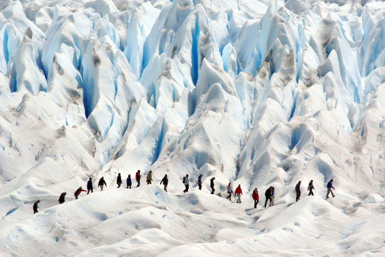 People climbing on snowcapped mountains