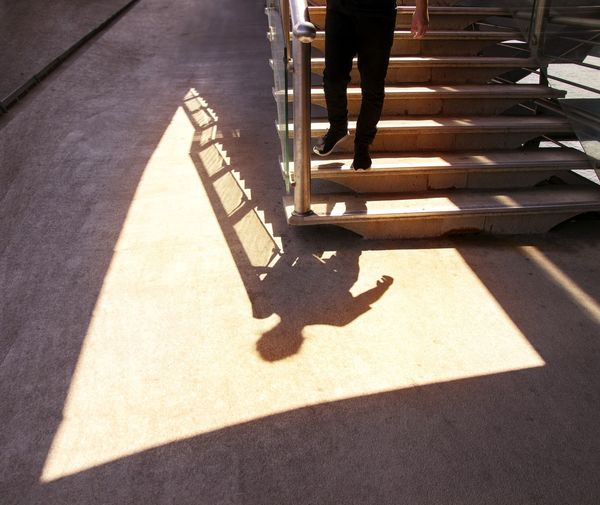Shadow on the staircase. Shadow Shadows & Lights Architectural Feature Architecture stairways Minimalism Lines And Shapes Design Down Shadow And Light Male Figure Photooftheday Photography EyeEm Gallery Lines Canon Architecture_collection Istanbul Low Section Shadow Human Leg Sunlight Stairs Staircase Asphalt Steps Hand Rail Stairway Long Shadow - Shadow The Architect - 2019 EyeEm Awards