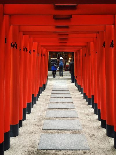 In A Row Orange Color Red The Way Forward Architecture Real People Built Structure Travel Destinations Tourism Architectural Column Steps Walking Travel Building Exterior Outdoors Full Length Day Men Place Of Worship People Shot On IPhone. The Graphic City