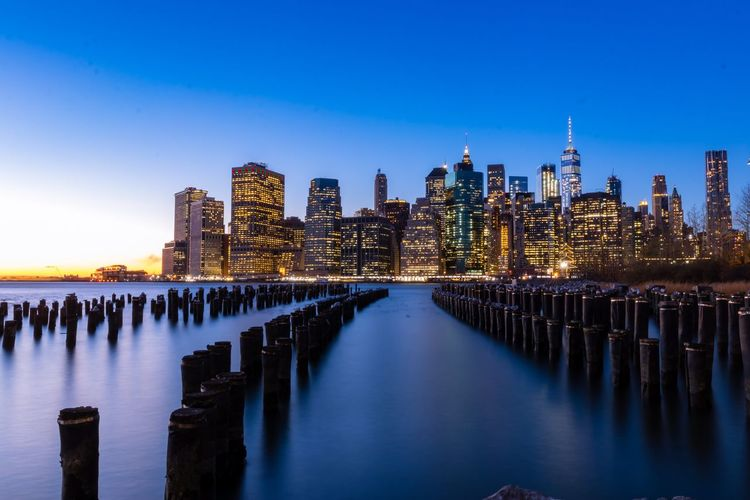 View of manhattan from brooklyn Architecture Built Structure Building Exterior Skyscraper Water Urban Skyline City Travel Destinations Blue Illuminated Outdoors Waterfront Cityscape Sky No People Clear Sky Cold Temperature Night Modern Sea EyeEmNewHere